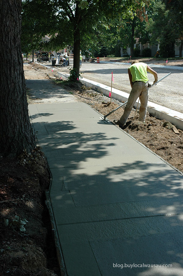 smoothing out the new sidewalks